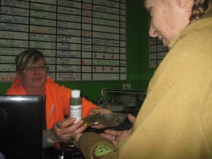 Gayle purchasing Arnica Massage oil and some CBD cannoil.