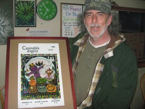 Ron Vanzetta holds his multi layered cut out colouring contest winner.