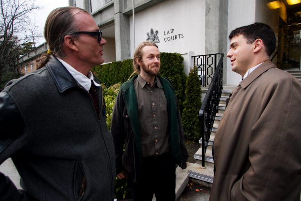 VICTORIA, B.C.: JANUARY 16, 2012 -left to right, Ted Smith, Owen Smith and lawyer Kirk Tousau outside of the Victoria Courthouse as members of the Compassion Club are on trial for baking marijuana goods in Victoria, B.C. January 16, 2012. (DARREN STONE, TIMES COLONIST). For City story by Louise Dickson.
